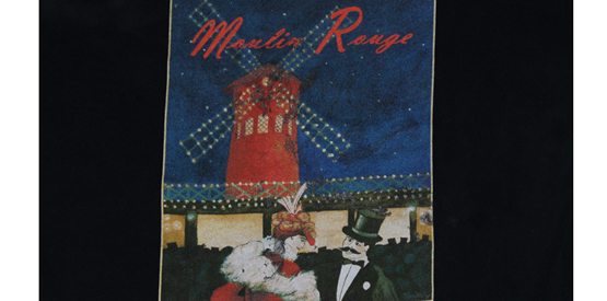 colorful screen print of Moulin Rouge art on a black shirt