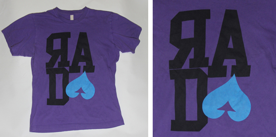 Custom screen print on a purple shirt by Spectrum Apparel Printing